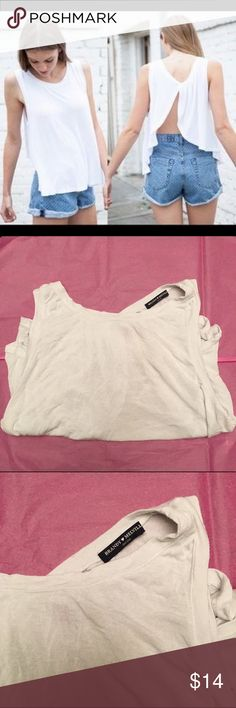❗️FLASH SALE❗️Brandy Melville Flowy Backless Tank Brandy Melville butterfly backless top! Loose flowy style and very flattering. Perfect with fun bandeaus or bralettes. One size fits all but would fit a small best. Worn but with lots of life left for fall. Completely sold out on Brandy Melville website and in stores!!! Brandy Melville Tops Tank Tops