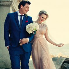 deep blue and pale pink wedding: Monaco blue groom's suit and linen pale pink bridal dress