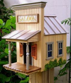 The SALOON Birdhouse has hand carved plank walls and front porch. Turned post and carved swinging doors. Theres a hand painted, framed sign and a stovepipe chimney. It is 11 High x 10 Deep x 7 Bird Houses Painted, Bird Houses Diy, Fairy Houses, Wood Bird Feeder, Bird House Feeder, Bird Feeders, Bird House Plans, Bird House Kits, Homemade Bird Houses