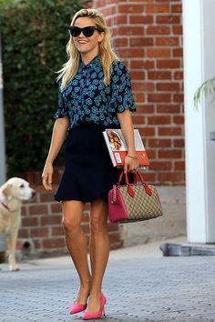 Reese Witherspoon wearing Draper James Margaret Solid Skirt, Gucci Gg Supreme…
