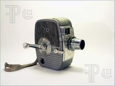 Google Image Result for http://www.featurepics.com/FI/Thumb300/20080210/Vintage-Camera-Camcorder-610414.jpg