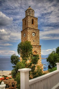 Greek Time by Tom Gomez  The clock tower in the village of Nimborio on the Greek Island of Halki (Chalki).