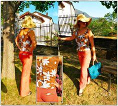 Completo FlowerPower: canotta in cotone fantasia con abbottonatura sul retro- pantalone a gamba ampia in lino, con tascino sul retro. In abbinamento: borsa di Le borse di Amalia