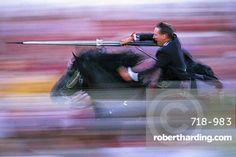 Rider speeding during the Medieval Games, festival celebrated on St. John's Day (Festa de Sant Joan), Ciutadella, Minorca (Menorca), Balearic Islands, Spain, Europe