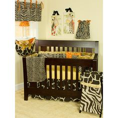 This eight-piece crib bedding set from Cotton Tale features a safari setting. Sporting a playful atmosphere in your babys room, the set includes two animal-themed pillows, a diaper stacker, toy bag, and more, and will create an attractive room.