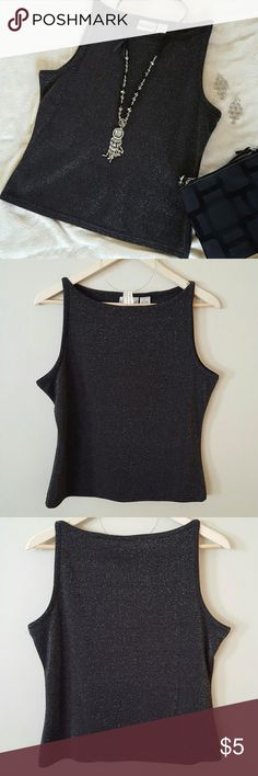 Sleeveless black Sparkle shirt This sleeveless shirt has a simple cut that can be worn with a cute pair of shorts. To take it to the next level bling it up and add to it's Sparkle for a night out on the town.  The shirt is a cotton polyester metallic blend. It is a size large and seems to run small... So it may be junior. Fashion Bug Tops Tank Tops