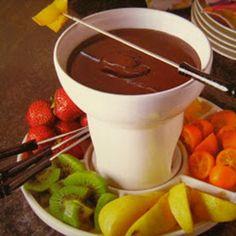 Fonduta di cioccolato con mandarini cinesi  e fragole.