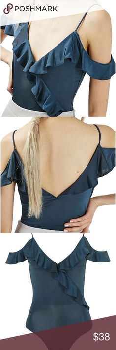New with Tag TopShop ruffle off shoulder bodysuit TopShop blue ruffled cold shoulder bodysuit. Put your feminine personality on center stage in this lustrous spaghetti-strap bodysuit outlined by fluttery ruffles. Plunging V-neck Spaghetti straps 94% polyester, 6% elastane Machine wash warm, dry flat By Topshop; imported Topshop Tops Blouses