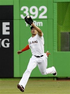 Giancarlo Stanton catches a ball hit by Alfonso Soriano. April 17, 2012