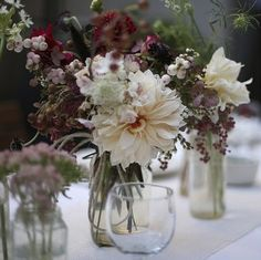 Table settings - monochromatic colour schemes in burgundy, with berried textures. Arrangement by Amy Merrick Seating Arrangement Wedding, Seating Plan Wedding, Wedding Arrangements, Floral Arrangements, Table Arrangements, Flower Arrangement, Ivory Wedding Flowers, Floral Wedding, Rustic Wedding