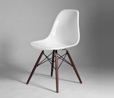 Eames' Dining Chair DSW Walnut  from Designers Revolt. Original quality designer classics at a fraction of the high street price. Join the Designers Revolt!