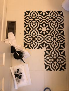 Stenciled floors in black and white paint