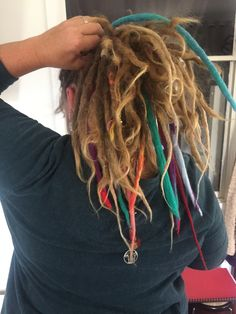 One of the perks of dread extensions is that you have more options in how you wear your hair