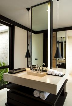 stylish black and pale sand bathroom-love the vanity with the one-piece countertop and sink!