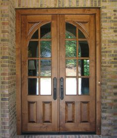 Brown Wooden French Country Double Door With Two Panel And Curved Glass Panel Using Black Handle Combined With Brick Wall With Wooden Front Doors With Glass Uk Also Double Exterior Doors With Glass