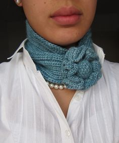 Free knitting pattern for Flower Scarf neckwarmer - Robyn Diliberto's fast project is knit in fisherman's rib and finished with a knitted flower and button. Pictured project is by chocoJ