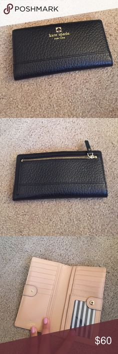 Preloved kate spade wallet Black with tan accent kate spade wallet! Plenty of card slots and holder for change! Wallet was used prior but in overall great condition. Make me an offer kate spade Bags Wallets