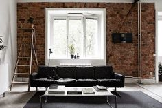 A cool fireplace in black and concrete | Fantastic Frank apartment (via Bloglovin.com )