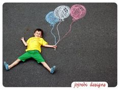 LOVE the idea of drawing a scene to photograph your child in.  They could even draw their own.