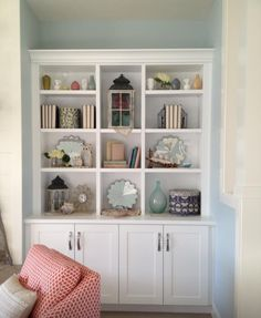 For niche: open shelves above (to the ceiling), doors below; paint the backs coral or or blue...tbd