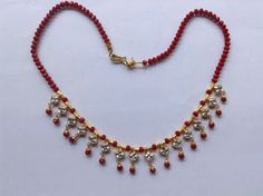 Ruby strand with stone danglers