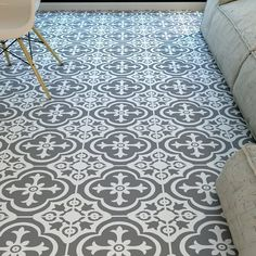 Peel and stick vinyl tile has been around for a long time, but you might be surprised to find that it's suddenly available in a huge variety of colors and patterns, many of which are designed to mimic much more expensive flooring choices, like travertine and cement tile