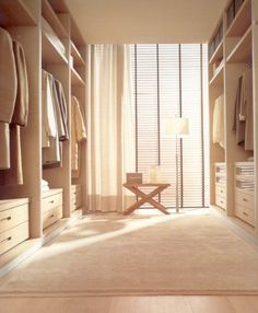 Love the neutral tones and the lightness of this walk-in wardrobe by Poliform