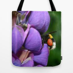 """Lupine and bumblebee Tote Bag by gunadesign - $22.00 Tote Bags are hand sewn in America using durable, yet lightweight, poly poplin fabric. All seams and stress points are double stitched for durability. They are washable, feature original artwork on both sides and a sturdy 1"""" wide cotton webbing strap for comfortably carrying over your shoulder."""