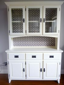 Painted Hutch.  Love the graphic paper extended all the way down.