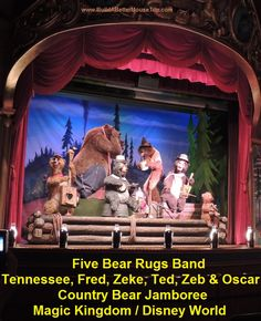 The Five Bear Rugs Band at the Country Bear Jamboree in the Magic Kingdom.  From left to right,  band members & their instruments: Tennessee (Thang), Fred (mouthharp), Zeke (banjo), Ted (cornjug), and Zeb (fiddle).  Baby Oscar is Zeb's son.