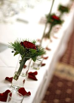 december wedding flowers. love this +the petals on the table :)