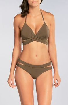 b6e503358f4 Mix it up with this cross front wrap top with a sexy plunging neckline and  molded booster cups for enhanced volume and support. Wala Swim