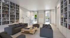 Long and bright. White floors, bookshelves all over the walls. The Whitman condos, NYC