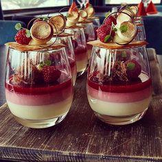 This pretty dessert from Design Cuisine is a passion fruit panna cotta garnished with malted milk meringues, topped with a chocolate cookie. Desserts In A Glass, Fancy Desserts, Köstliche Desserts, Plated Desserts, Delicious Desserts, Dessert Recipes, Raspberry Desserts, Weight Watcher Desserts, Patisserie Fine
