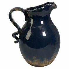 "Ceramic pitcher in navy blue with a glossy finish and curved handle.   Product: PitcherConstruction Material: CeramicColor: NavyDimensions: 12"" H x 9.5"" W x 7.5"" D"