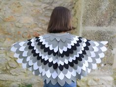 Dress up wing cape for children. Kids bird wing set in black, grey and white for Halloween, Carnival or any disguise fun play.