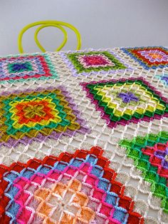 The new granny square blanket, Bavarian Squares; free crochet pattern therefore on http://www.favecrafts.com/Crochet/How-to-Crochet-a-Bavarian-Square