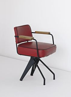 JEAN PROUVÉ Very rare swivelling office chair, special model, 1950 Painted bent sheet steel, painted tubular steel, vinyl, oak. 80 cm. (31 1/4 in.) high Manufactured by Les Ateliers Jean Prouvé, France