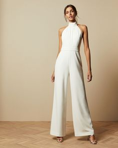 A one-piece wonder that's sure to turn heads, the OLIVYA jumpsuit from Ted is an eye-catching addition to any smart wardrobe. The elegant halterneck and statement wide legs combine in this eye-catching design that's guaranteed to make an impression.