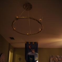 DYI chandelier, made from a hulu hoop covered in ribbon.  The candles are battery operated fake candles in plastic goblets, both from the dollar store. Medieval Banquet, Viking Dragon, Western Parties, Dragon Party, Vbs Crafts, Candle Chandelier, Armor Of God, How To Train Your Dragon, Battery Operated
