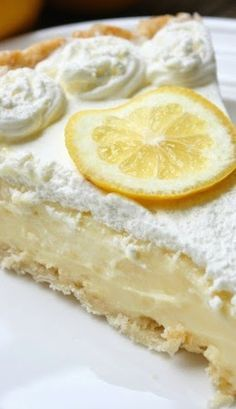 Lemon Sour Cream Pie ~ Perfect level of lemon tartness combined with the perfect level of creaminess. This pie is absolutly fantastic and definitely a new favorite!: