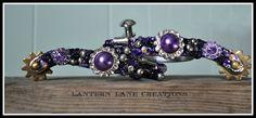 Custom purple youth spurs