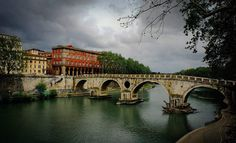 Postcards From Rome: The Arches O'er River Tiber... Rome Italy  On a  gorgeous cloudy day I walked along the river and contemplated. I really hadn't used my camera much yet; I was mostly just soaking in the vibe enjoying the air feeling amazed I was in Rome - which had only been a dream I'd held for so long.   This moment happened. Landscape yes. But containing the sense of reflection color mood and just-outside-the frame activity that I felt in my mind that day. Stirring unsettled in…