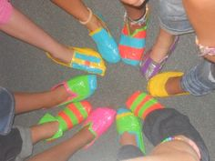 "Duct tape shoes...would be a fun first day activity to go along with the ""stand"" in Stand Ye in Holy Places theme.  The girls could wear them as slippers while in their tents."