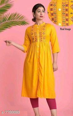 Kurtis & Kurtas Women's Embroidered Yellow Rayon Kurti Fabric: Rayon Sleeve Length: Three-Quarter Sleeves Pattern: Embroidered Combo of: Single Sizes: XL (Bust Size: 40 in Size Length: 48 in)  L (Bust Size: 38 in Size Length: 48 in)  M (Bust Size: 36 in Size Length: 48 in)  XXL (Bust Size: 42 in Size Length: 48 in)  Country of Origin: India Sizes Available: S, M, L, XL, XXL, XXXL   Catalog Rating: ★4.2 (460)  Catalog Name: Adrika Alluring Kurtis CatalogID_1275152 C74-SC1001 Code: 904-7799989-6201
