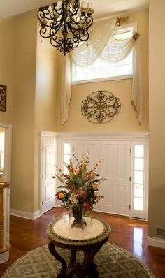 Foyer Window Treatment - traditional - entry - new york - Decorating Den Interiors - Susan Keefe, C. Arched Windows, High Windows, Foyer Decorating, Decorating Ideas, Curtain Designs, Elegant Homes, Window Treatments, Window Coverings, Entryway Decor