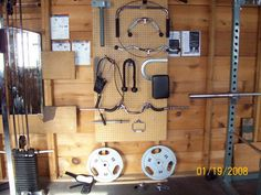 nice wall of pulldown attachments - not your usual garage gym piece of equipment but nice