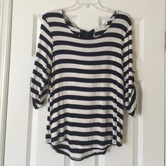 Navy & white stripe top with keyhole & bow in back Navy & white stripe top with keyhole & bow in back. Large Faith & Joy Tops