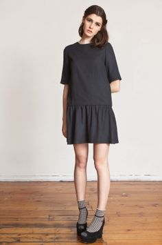 Dropped waist dress, gathered skirt. Made out of 100% silk. Invisible zip at back.