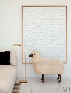 In Daniel Romualdez's Los Angeles living room, a Lalanne sheep stands before a painting by Sean Landers.